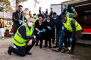 Bill Shorten (left) poses with staff from Macca Halal Foods and volunteers after delivering 5 tons of halal meat for the residents of Alfred Street as they remain locked down during COVID-19 on 10 July, 2020 in Melbourne, Australia. Former Federal Labor Leader Bill Shorten, along with close allies at Trades Hall help deliver Halal meat, supplied by Macca Halal Foods to the locked down housing commission towers following a coronavirus outbreak detected inside the complex. Mr Shorten was able to use his high profile to ensure food was not turned away by police so that it would reach the residents inside. (Photo be Dave Hewison/ Speed Media)
