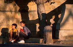 MALTA GOZO SANNAT JUL00 - Children sit on stairs at the foot of Sannat church.. . jre/Photo by Jiri Rezac. . © Jiri Rezac 2000. . Tel:   +44 (0) 7050 110 417. Email: info@jirirezac.com. Web:   www.jirirezac.com