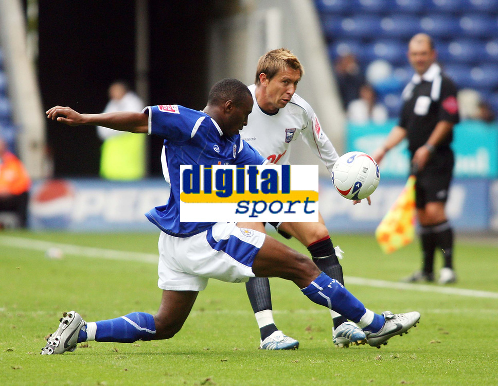 Photo: Chris Ratcliffe.<br />Leicester City v Ipswich Town. Coca Cola Championship. 12/08/2006.<br />Darren Currie (R) of Ipswich clashes with Darren Kenton of Leicester.