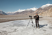 Matthieu Paley shooting video on the Wakhan river..Leaving Sarhad village (end of the road in the Wakhan Corridor), to trek up to the Little Pamir with yak caravan over the frozen Wakhan river.