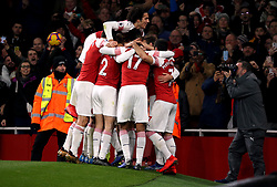 Arsenal's Lucas Torreira celebrates scoring his side's first goal of the game with his team-mates during the Premier League match at the Emirates Stadium, London.