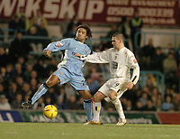 Fotball<br /> England 2004/2005<br /> Foto: SBI/Digitalsport<br /> NORWAY ONLY<br /> <br /> Coca-Cola Championships<br /> 03/01/2005.<br /> <br /> Coventry City v Leeds United<br /> <br /> Coventrys Richard Shaw takes on David Healy