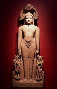 A Jina in sandstone from Madhya Pradesh, 1000-1100 AD. Accompanied by attendants, this jain saviour figure (Jina), meditates.