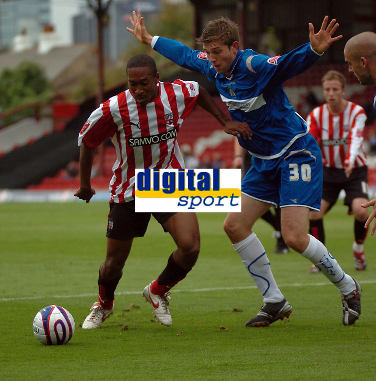 Photo: Tony Oudot.<br /> Brentford v Stockport County. Coca Cola League 2. 29/09/2007.<br /> Ricky Shakes of Brentford with Dominic Blizzard of Stockport