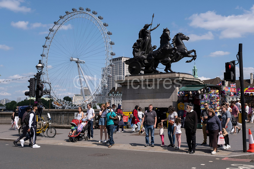 With many people and families staying in the UK for their Summer break during the school holidays, a large number of domestic tourists, who may normally have been travelling abroad, have decended on the capital to see the sights, as seen here on Westminster Bridge on 11th August 2021 in London, United Kingdom. Following the Coronavirus / Covid-19 health scare of the last two years, and with some travel restrictions still in place, more people have chosen a staycation which is a holiday spent in ones home country rather than abroad, or one spent at home and involving day trips to local attractions.