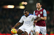 Wes Morgan of  Leicester city (l) shields the ball from Libor Kosak of Aston Villa. Barclays Premier league match, Aston Villa v Leicester city at Villa Park in Birmingham, The Midlands on Saturday 16th January 2016.<br /> pic by Andrew Orchard, Andrew Orchard sports photography.