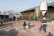 """Nederland, Herpen, 20090128...De kinderen maken een wandeling..Kinderopvang 'Op de boerderij' in Herpen...""""OP DE BOERDERIJ"""" kinderopvang..is gevestigd bij een vleesveebedrijf te Herpen...Wandelen op het erf van de boerderij....Netherlands, Herpen, 20090128. ..The children take a walk..Childcare on the farm in Herpen. ..""""ON THE FARM"""" childcare ..is located at a beef farm in Herpen.    .."""
