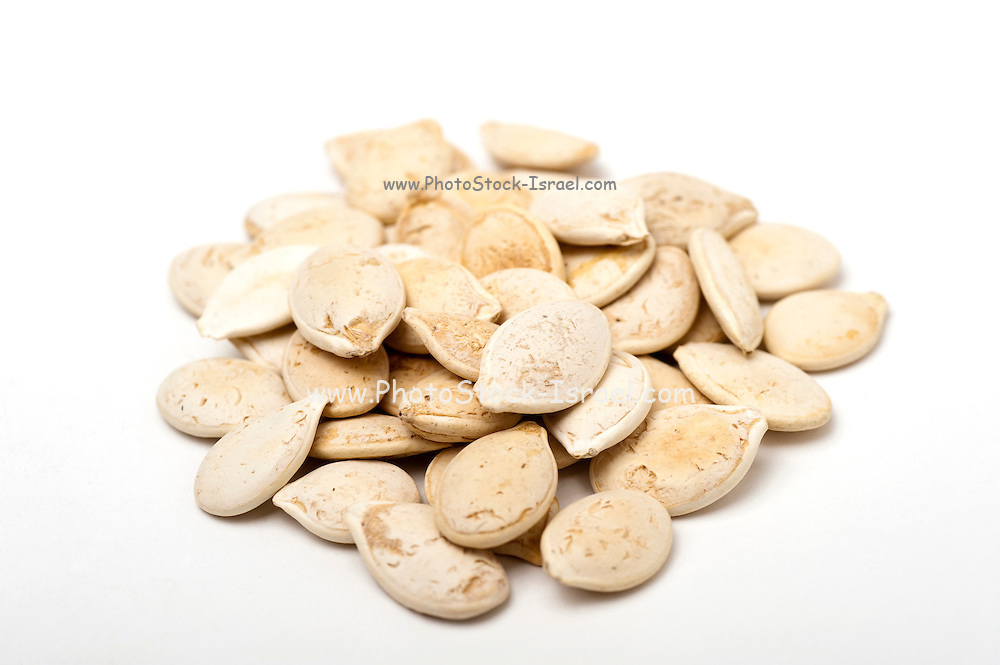 Roasted unshelled pumpkin seeds On white Background