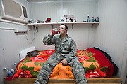 A soldier inside his Container Living Units (CLU - this area is known as Cluville) where he lives..Life at Camp Lemonnier, a United States Naval Expeditionary Base, a garrison part of the Combined Joint Task Force-Horn of Africa...Camp Lemonnier is on B Alert (same level of security as Afghanistan or Iraq)...The geostrategical and geopolitical importance of the Republic of Djibouti, located on the Horn of Africa, by the Red Sea and the Gulf of Aden, and bordered by Eritrea, Ethiopia and Somalia.