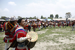 May 5, 2018 - Nepal - Nepalese Kiratis play traditional music instruments during the celebration of Ubhauli festival. The Kiratis are the inhabitants of eastern hilly regions in Nepal and the Ubhauli festival marks the beginning of farming seasion and the migration phase upwards to hilly region at the arrival of summer season. (Credit Image: © Milan Adhikari/Pacific Press via ZUMA Wire)