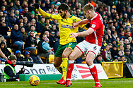 Norwich City striker Nelson Oliveira (9) Barnsley defender Liam Lindsay (6) battles for possession during the EFL Sky Bet Championship match between Norwich City and Barnsley at Carrow Road, Norwich, England on 18 November 2017. Photo by Phil Chaplin.