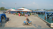 Passengers at a port in Ko Pha-ngan, Thailand