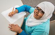 Cunningham Elementary School fifth grader Maryam Al-Saidi poses for a photograph, April 3, 2014.