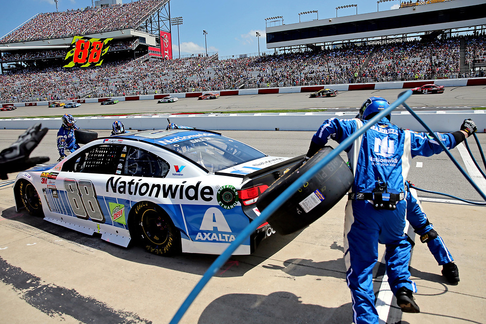 Apr 30, 2017; Richmond, VA, USA; NASCAR Cup Series driver Dale Earnhardt Jr. (88) makes a pit stop during the Toyota Owners 400 at Richmond International Raceway. Mandatory Credit: Peter Casey-USA TODAY Sports