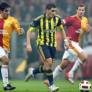 Galatasaray's Juan Emmanuel CULIO (L) and Fenerbahce's Ozer HURMACI (C) during their Turkish superleague soccer derby match Galatasaray between Fenerbahce at the Turk Telekom Arena in Istanbul Turkey on Friday, 18 March 2011. Photo by TURKPIX