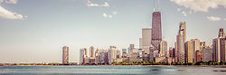 Chicago skyline panorama photo with retro vintage tone. Panorama photo ratio is 1:3 and includes Chicago lakefront downtown city buidlings on the Near North Side. Includes the John Hancock Center Building which is a famous part of the Chicago skyline and is one of the tallest skyscrapers in the world.