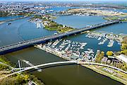 Nederland, Noord-Holland, Amsterdam, 20-04-2015; Zeeburgerbrug (Ringweg A 10) over water van het Nieuwe Diep en IJmeer (Buiten-IJ). Foto richting Eiland Zeeburg (Zeeburger eiland). Amsterdam-Rijnkanaal met Nesciobrug in de voorgrond.<br /> Amsterdam Ring Road near IJburg, the new urban development district of Amsterdam.<br /> luchtfoto (toeslag op standard tarieven);<br /> aerial photo (additional fee required);<br /> copyright foto/photo Siebe Swart