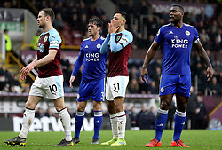 Burnley's Dwight McNeil (second right) reacts after a chance on goal during the Premier League match at Turf Moor, Burnley.