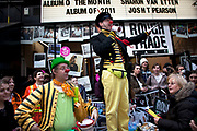 Compares and judges at the Great Spitalfields Pancake Race on Shrove Tuesday, pancake day, at the Old Truman Brewery, London, UK. This is a fun quirky annual event where competitors come as teams of four people dressed up in costume of some kind. Organised by Alternative Arts raising money for charity.