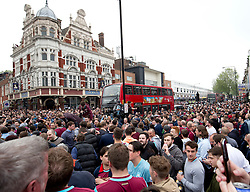 © Licensed to London News Pictures. 10/05/2016. LONDON, UK. West Ham United's fans are in a celebratory mood  before the clubs final game at the Boleyn Ground against Manchester United. Photo credit: LNP