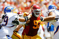 5 September 2009: #92 Hebron Fangupo pushes off opposing players of the University Southern California USC Trojans Pac-10 college football team during a 56-3 victory over the WAC San Jose State Spartans at the Los Angeles Memorial Coliseum in Southern California.