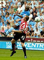 Photo: Ed Godden.<br /> Coventry City v Sunderland. Coca Cola Championship. 06/08/2006. Coventry's Stern John rises high above Steven Caldwell.