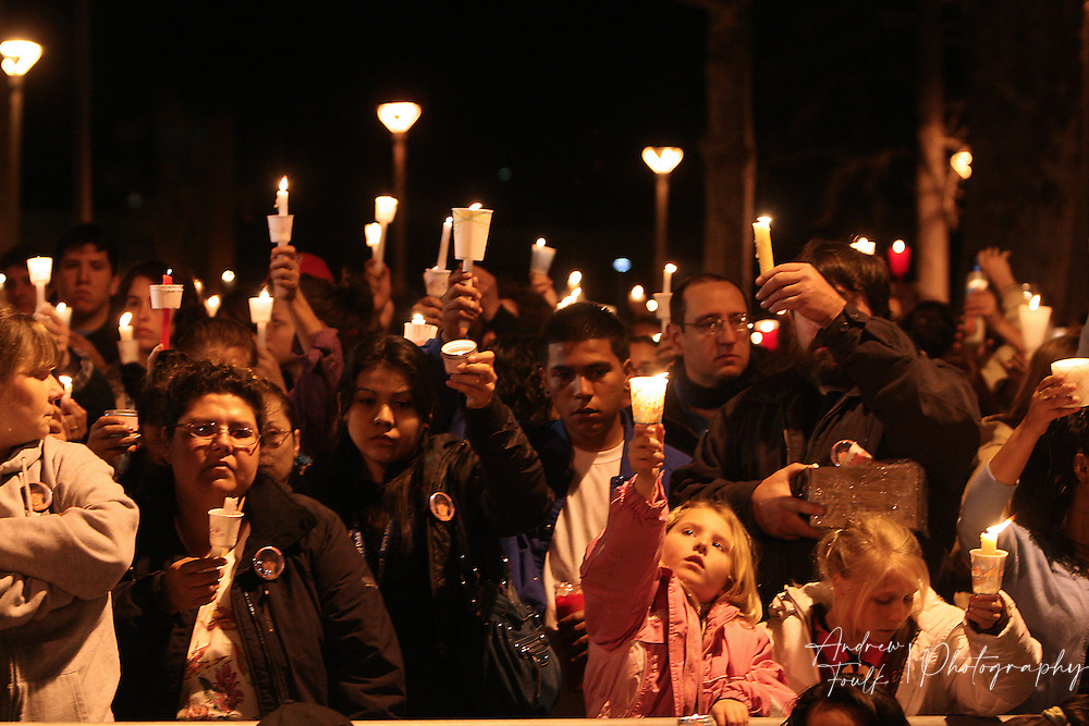 /Andrew Foulk/ For the North County Times/  .Mourners hold candles high in the air during a Vigil to remember Amber Dubois at Escondido High School Monday night.