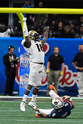 UCF Knights linebacker Shaquem Griffin (18) reacts after sacking Auburn Tigers quarterback Jarrett Stidham (8) during the second half of the Chick-fil-A Peach Bowl NCAA college football game at the Mercedes-Benz Stadium in Atlanta, January 1, 2018. UCF won 34-27 to go undefeated for the season. (David Tulis via Abell Images for Chick-fil-A Peach Bowl)