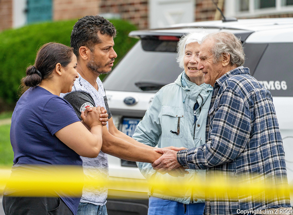 Imane Loffi, 33 (Left) and her husband, Elsayed Elsayed, 46, comfort Boris Pevzmer, (right) 94, and Natalya Kirillova, 82, at the scene. The home of Pevzmer and Kirillova suffered smoke and water damage, along with having the windows blown out.