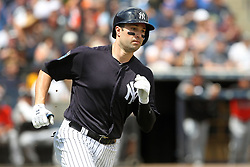 March 18, 2018 - Tampa, FL, U.S. - TAMPA, FL - MAR 18: Neil Walker (14) of the Yankees hustles down to first base during the game between the Miami Marlins and the New York Yankees on March 18, 2018, at George M. Steinbrenner Field in Tampa, FL. (Photo by Cliff Welch/Icon Sportswire) (Credit Image: © Cliff Welch/Icon SMI via ZUMA Press)