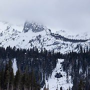 Crystal Crag, one of Mammoth Lakes' most distinctive rock formations, is obscured in clowds from a approaching winter storm.