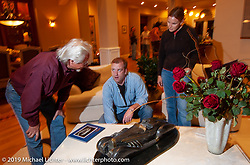 Arlen Ness and cameraman Loy Norrix at a celebration at Bev's and Arlen Ness' home for the unveiling of the completed Top Banana Biker Build-Off bike. Alamo, CA. 2004. Photograph ©2004 Michael Lichter