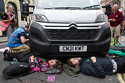 Environmental activists from Extinction Rebellion use a lock-on under a vehicle to block a road in the Covent Garden area during the first day of Impossible Rebellion protests on 23rd August 2021 in London, United Kingdom. Extinction Rebellion are calling on the UK government to cease all new fossil fuel investment with immediate effect. (photo by Mark Kerrison/In Pictures via Getty Images)