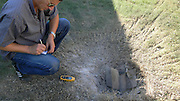 Israel, Sderot, surveyor marking the location of the remains of a Qassam rocket launched by Hamas with a GPS from Gaza August 6th 2007