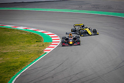 February 19, 2019 - Montmelo, Barcelona, Spain - Barcelona-Catalunya Circuit, Montmelo, Catalonia, Spain - 19/02/2018: Pierre Gasly of Aston Martin RedBull Racing with the new RB15 is passed by Daniel Ricciardo's car during second journey of F1 Test Days in Montmelo circuit. (Credit Image: © Javier Martinez De La Puente/SOPA Images via ZUMA Wire)