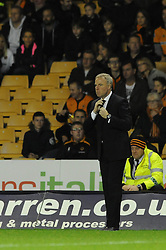 Huddersfield Town Manager, Chris Powell adjusts his tie - Photo mandatory by-line: Dougie Allward/JMP - Mobile: 07966 386802 - 01/10/2014 - SPORT - Football - Wolverhampton - Molineux Stadium - Wolverhampton Wonderers v Huddersfield Town - Sky Bet Championship