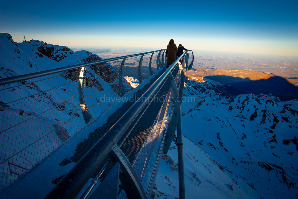 The 12m Ponton dans le ciel, a glass walkway high above the Pyrenees at Pic du Midi de Bigorre, a 2877m mountain in the French Pyrenees, home to an astronomical observatory and visitors centre. The observatory is acccessible from the village of La Mongie by cablecar. Tourists often visit in time for the spectacular sunset across the mountains.