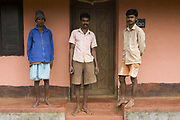Three 3 Indian Hindu men standing outside their house on a coffee plantation. Coorg or Kadagu is the largest coffee growing region of India, in the state of Karnataka, the inhabitants - the Kodavas have been cultivating crops such as coffee, black pepper and cardamon for many generations.