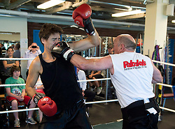 Federal Liberal Leader Justin Trudeau, left, gets tagged with a left by Mickey MacDonald, a Halifax-area entrepreneur and philanthropist, at Palooka's Gym in Bedford, N.S. on Monday, August 25, 2014. MacDonald, a former competitive boxer, is hosting a fund-raising event at his residence for Trudeau later in the day. THE CANADIAN PRESS/Andrew Vaughan /ABACAPRESS.COM  | 521043_023 Bedford Canada