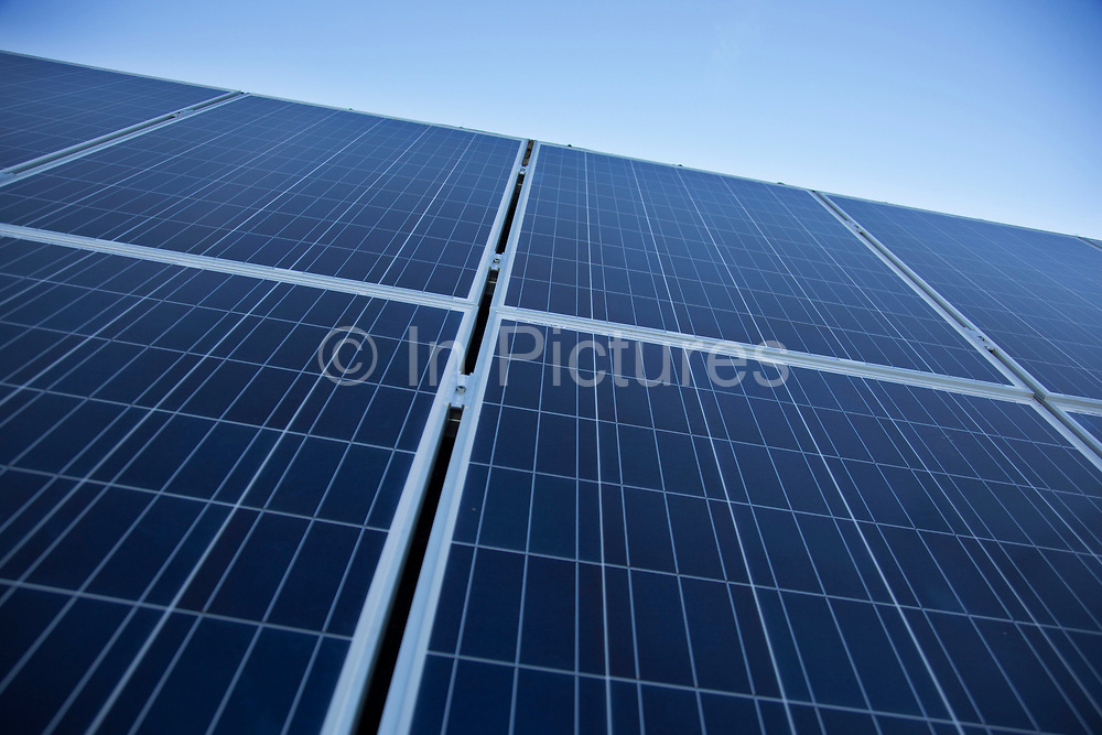 Solar panels being installed as part of a renewable green energy policy run by the local authority in conjunction with solar panel companies. Reading, UK.