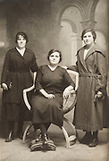vintage photo of 3 girls posing in studio