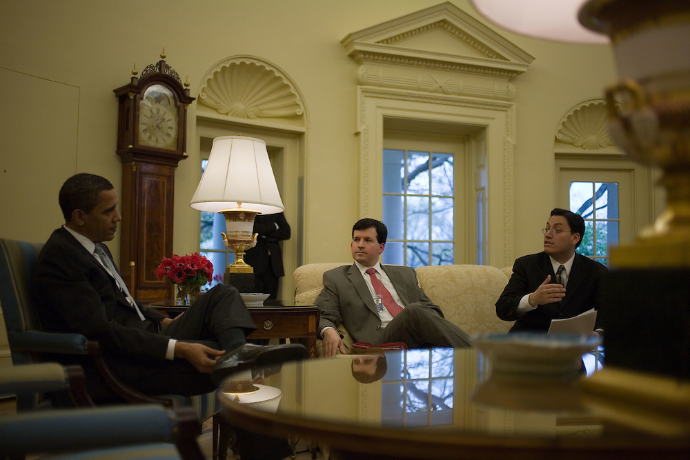 U.S. President Barack Obama meets with advisors prior to his trip to Mexico City in the Oval Office at the White House in Washington on Wednesday, April 15, 2009.