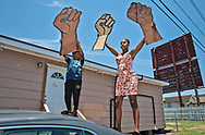 Milan Sherry founder of the NOLA Trans March with Ishai Smyth in Harvey at a protest held by families of young black men killed by the Jefferson Parish police over the last two years.