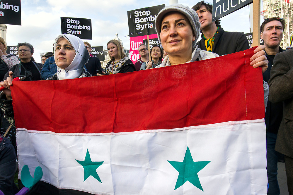"""""""Stop the Rush to War: Don't Bomb Syria"""" <br /> People rally at a protest organised by the Stop the War Coalition against air strikes in Syria. Parliament Square, Westminster, London, UK. 16th April 2018."""