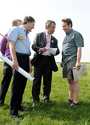 © under license to London News Pictures. 7/12/13 A pilot who was at the controls of a plane that crashed injuring UKIP leader Nigel Farage has been found dead.<br /> <br /> FILE PICTURE  © under license to London News Pictures. 01/12/2010 Pictured: Nigel Farage and Justin Adams (R) photographed a week before the flight which crashed. Justin Adams, the pilot of the plane which crashed and injured Nigel Farage has been charged with threatening to kill the politician. Picture credit should read Stephen Simpson/London News Pictures
