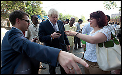 Boris Johnson with his private secretary Ben Gascoigne (left) and Hilary Merrett - Deputy Head of Media (right) after a live interview on his mobile. Later he will come up against India's equivalent of David Letterman today as he appears on one of the country's most famous current affairs programmes. The London mayor, who will round off the tour of India to promote business links with the capital, will also visit the Bombay stock exchange before he appears on Times Now with Arnab Goswami. Goswami is one of India's most prominent chat show hosts and has also interviewed Gordon Brown, Hillary Clinton and Sonia Gandhi.  Friday November 30, 2012. Photo by Andrew Parsons / i-Images