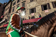 "Italy, Siena, the Palio: preparing for the  trial called "" Provaccia"" , the bad trial, for the lack of enthuasiasm shown by the jockeys who spare the horses for the demanding evening race After this test, captains and jockeys gather at the City Hall to enscribe the jockey and show his colors. After this the jockey can no longer be changed."