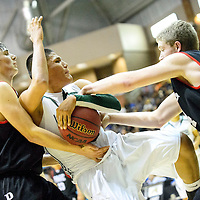 021214  Adron Gardner/Independent<br /> <br /> Tuba City Warrior Tyler Johnson (25) Page Sand Devils, Carson Wright (20), left, and Roger Sandall (34) in Chinle Wednesday.