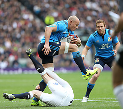26 February 2017 : 6 Nations Rugby : England v Italy :<br /> Italian captain Sergio Parisse steps over the fallen English tackler, Elliot Daly.<br /> Photo: Mark Leech