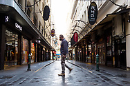 A man crosses an empty laneway in the CBD during COVID-19 in Melbourne, Australia. Hotel quarantine linked to 99% of Victoria's COVID-19 cases, inquiry told. This comes amid a further 222 new cases being discovered along with 17 deaths. Melbourne continues to reel under Stage 4 restrictions with speculation that it will be extended. (Photo by Dave Hewison/Speed Media)